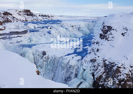 Gullfoss waterfall in the snow in winter located in the canyon of Hvítá river, Haukadalur, southwest Iceland - Stock Photo
