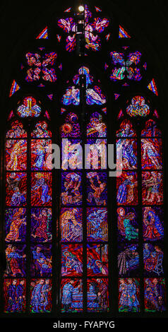 Stained Glass window in St. Vitus Cathedral, Prague, depicting scenes of the Passion of Jesus Christ - Stock Photo