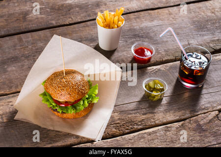 Burger and sliced pickles. - Stock Photo