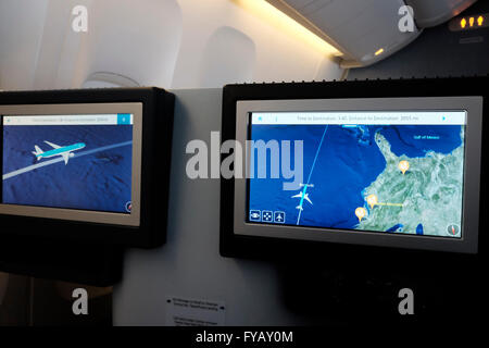 An Aeroplane flight position map showing aircraft position above Bermuda in a KLM Boeing airplane - Stock Photo
