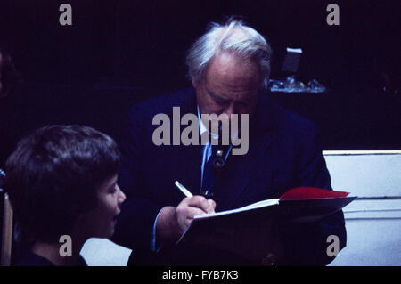 Archive image of Sir Patrick Moore, OBE, 1923-2012, astronomer, signing a copy of his book, Pennell-Hammerton Observatory, - Stock Photo