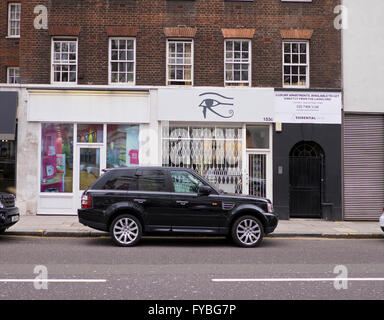 West London, UK. 24th April, 2016. Optician boutique in the Fulham road formerly known as ISIS forced to change - Stock Photo
