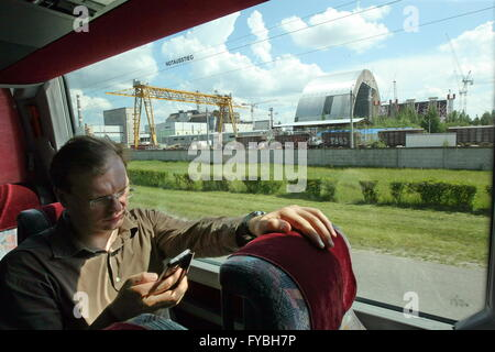 CHERNOBYL, UKRAINE. Pictured in this file image is a tourist bus driving in the Chernobyl Exclusion Zone. On April - Stock Photo