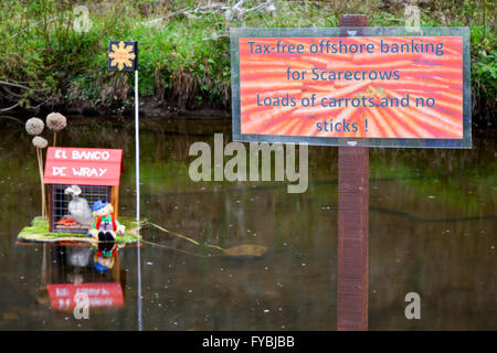 Tax-free offshore banking sign in Wray, Lancashire, UK 25th April, 2016.   Wray Annual Scarecrow Festival, weird, - Stock Photo