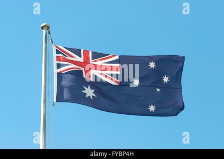 Australian flag flying on flagpole, Sydney, New South Wales, Australia - Stock Photo