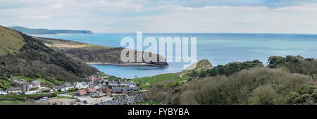 Panoramic view from the Southwest Coast Path over Lulworth Village, Lulworth Cove and Worbarrow Bay, Dorset, UK - Stock Photo