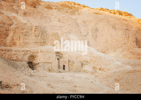 Image of a temple entrance in the side of the rock. Valley of the Queens, Egypt. - Stock Photo