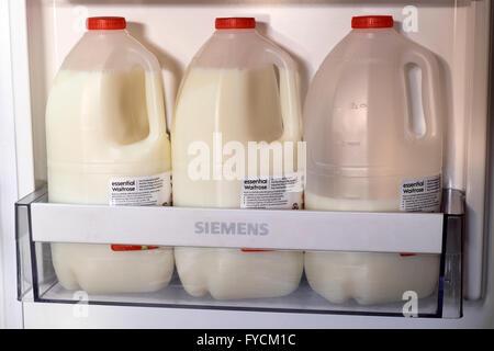 Essential Waitrose skimmed milk in fridge - Stock Photo