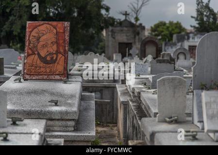 Carved stone work tombstones, memorials and sculptures adorn the graves at the Necropolis de Colon, Havana, Cuba - Stock Photo