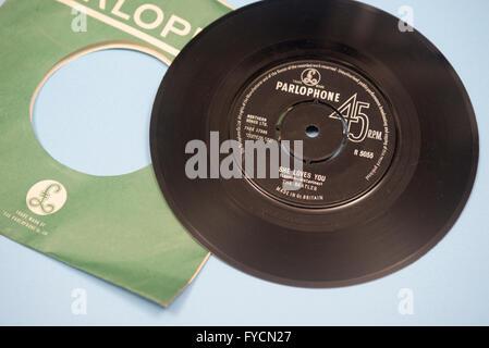 Beatle single on vinyl, She Loves You. - Stock Photo