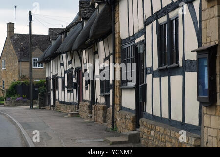 Row of thatched cottages on the High Street in Mickleton, Gloucestershire, England, UK. - Stock Photo