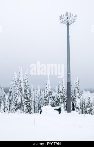 Snow covered telecommunication towers in the winter - Stock Photo