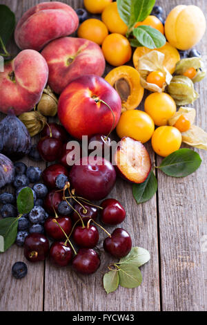 summer wooden table summer fruits on white wooden table apricots and cherries on