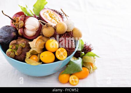 Exotic fruits on white background - Stock Photo
