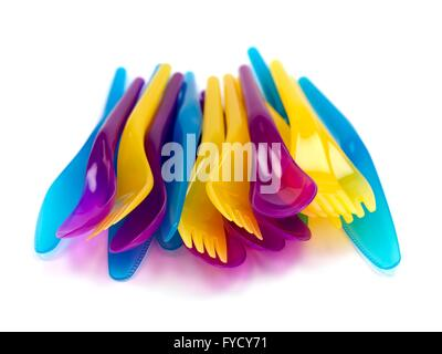 Plastic cutlery isolated against a white background - Stock Photo