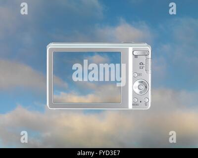 A compact camera with a photo of a blue sky - Stock Photo