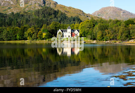 A view of Glenfinnan House Hotel from across Loch Shiel, Glenfinnan, Scotland, UK. - Stock Photo