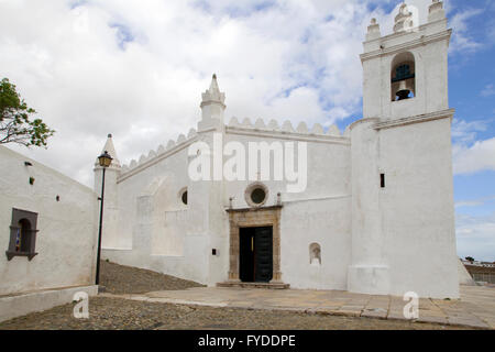 The main church at Mertola, Portugal.  Originally a mosque, it was converted to a church after the Christian conquest - Stock Photo