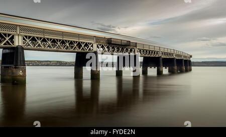 A long exposure of a train crossing the Tay rail Bridge - Stock Photo