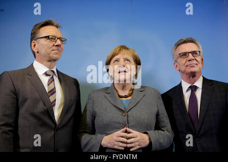 German Chancellor Angela Merkel, center, poses for media with Holger Muench, left, President of the Federal Criminal - Stock Photo