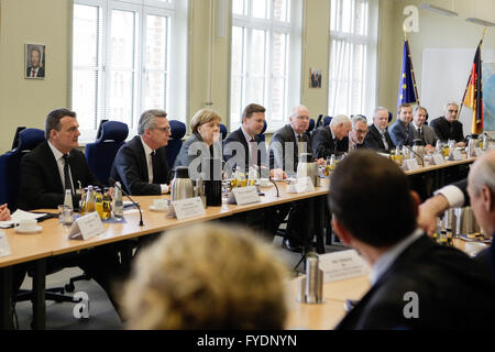 Berlin, Germany. 26th April, 2016. German Chancellor Angela Merkel, third from left, sits next to Interior Minister - Stock Photo