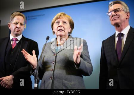 Berlin, Germany. 26th April, 2016. German Chancellor Angela Merkel stands between Hans-Georg Maassen, left, President - Stock Photo