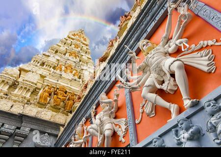 Rainbow Over Dravidian Architecture Exterior of Sri Senpaga Vinayagar Hindu Temple in Singapore - Stock Photo