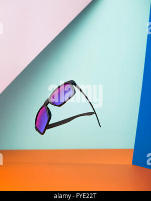 oakley glasses stock  creative shot of a floating pair of oakley sunglasses against multiple colours stock photo