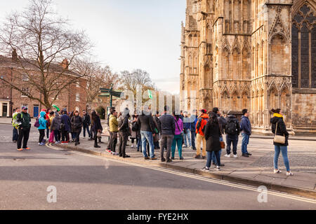 Large group of Asian tourists at York Minster, North Yorkshire, England, UK - Stock Photo