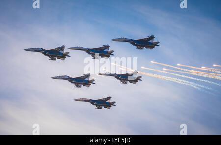 SAINT PETERSBURG, RUSSIA - April, 25, 2015: Flying display and aerobatic show of Russian Knights (Russkie Vityazi) - Stock Photo