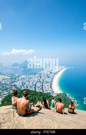 RIO DE JANEIRO - MARCH 9, 2016: Visitors take in the view of the city skyline after a hike to the top of Two Brothers - Stock Photo
