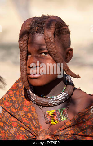 THE HIMBA are a nomadic people of Namibia. They adorn themselves with leather collars and brass rings and coat their - Stock Photo
