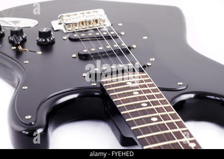 Black electric guitar on white background - Stock Photo