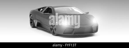 A model sports car isolated against a white background - Stock Photo