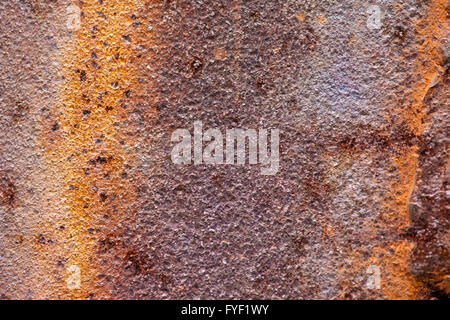 The metal plate badly damaged by rust - Stock Photo