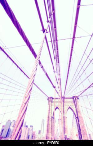 Vintage toned blurred photo of the Brooklyn Bridge, NYC.