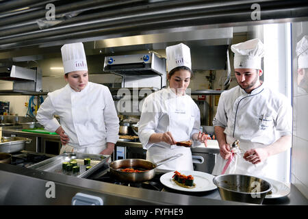 Students of Hospitality and Culinary Arts Institute of Saint-Gratien, France - Stock Photo