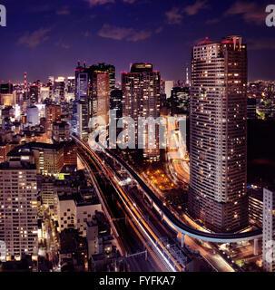 Highways and train lines at night, Minato, Tokyo, Japan - Stock Photo