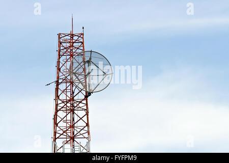 Satellite Dish on Telecommunication Radio antenna Tower - Stock Photo