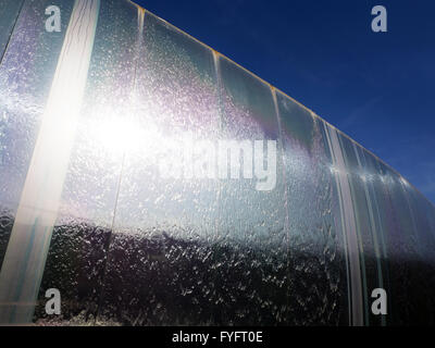 Light reflecting off the stainless steel Cutting Edge sculpture in Sheaf Square Sheffield South Yorkshire England - Stock Photo