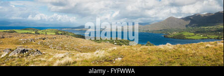 Panoramic view over Ardgroom Harbour with light green drumlins along Kenmare Bay to Iveragh from Kilcatherine, Beara - Stock Photo