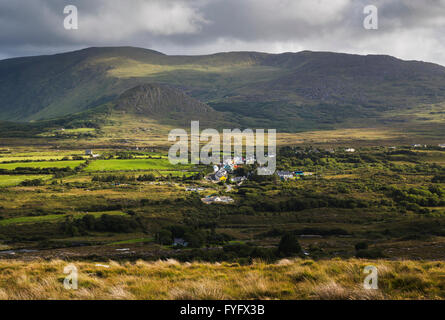 View over the picturesque and colourful village of Ardgroom from Kilcatherine, Beara Peninsula, County Cork, Ireland - Stock Photo