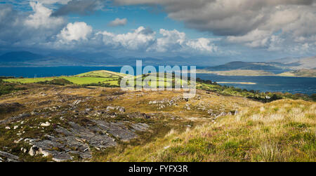 View north-eastwards over Ardgroom Harbour with prominent light green drumlins along Kenmare Bay to Iveragh from - Stock Photo