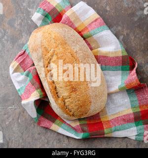 whole italian bread on napkin close-up - Stock Photo