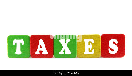 taxes - isolated text in wooden building blocks - Stock Photo
