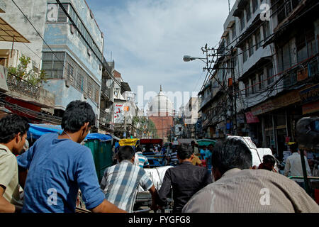 Crowd and dome of Jama Masjid Mosque, Old Delhi, India - Stock Photo