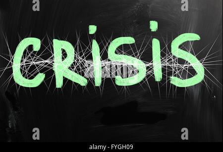 Crisis handwritten with white chalk on a blackboard - Stock Photo