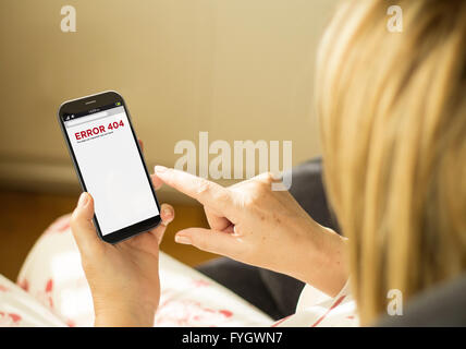 modern communications concept: mature woman with 3d generated touchscreen smartphone with error 404 on the screen. - Stock Photo