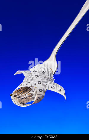Fork with Tape Measure, Dieting Concept Obesity - Stock Photo
