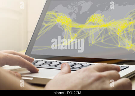 world connection concept: man using laptop with world connection map on the screen - Stock Photo
